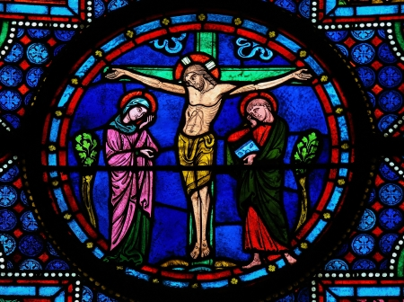 Stained glass window depicting Jesus on the Cross in the cathedral of Bayeux, Normandy, France. This window was created in the 15th century, no property release is required.