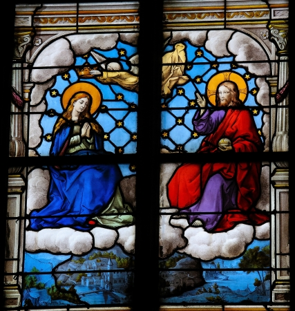 mother mary: Jesus and Mother Mary in Paradise on a stained glass window in Saint Catherines church in Honfleur, Calvados, France. This window was created in the 19th Century. No property release is required.