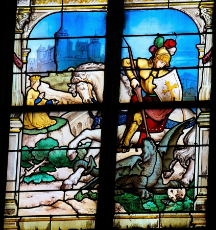 slaying: Saint George slaying the dragon. This window was created in the 19th Century. No property release is required.