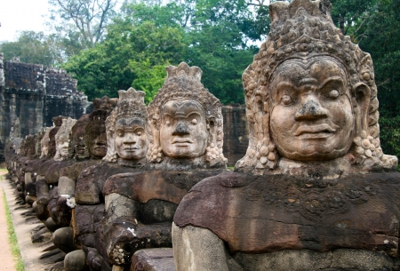 Sculptures at the entrance of Angkor Thom temple, in Angkor complex, Cambodia.  photo