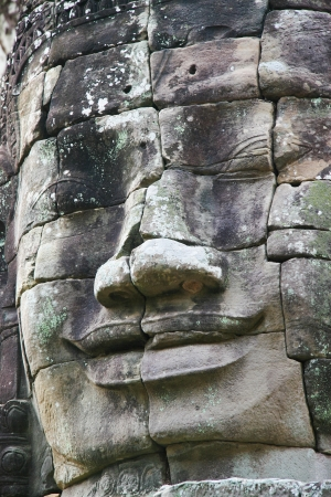 Detail sculpture at Bayon temple in Angkor Wat complex, Cambodia.  photo