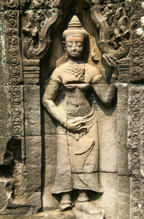 Apsara sculpture at Banteay Kdei, meaning A Citadel of Chambers, also known as Citadel of Monks cells, a Buddhist temple in Angkor, Cambodia.   photo
