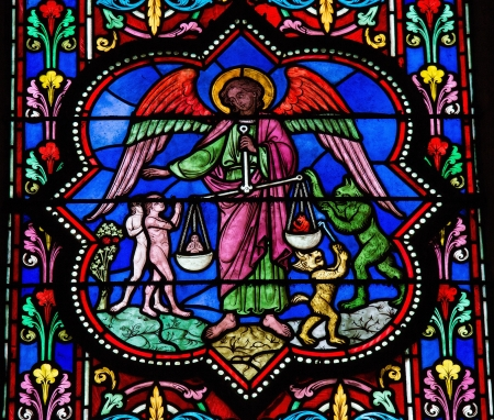 Stained glass window depicting Saint Michael the Archangel at the Final Judgement, in Bayeux, Calvados, France