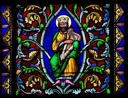 psalm: Stained Glass window depicting King David, in Bayeux, Calvados, France    Editorial