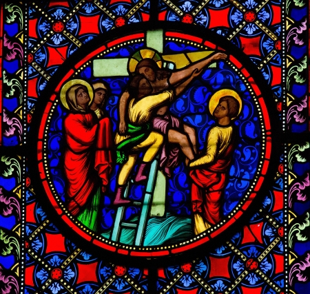 depicting: Stained Glass window depicting Jesus taken from the cross, in Bayeux, Calvados, France  Editorial