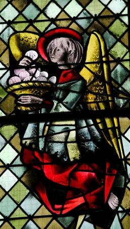 Angel with a Eucharist on a stained glass in the cathedral of Rouen, France, on February 10, 2013. This window was created more than 500 years ago, no property release is required.