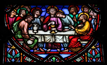 Stained glass window depicting Jesus and the twelve apostles on maundy thursday at the Last Supper in the cathedral of Brussels on July, 26, 2012   This window was created in the 19th Century  No property release is required