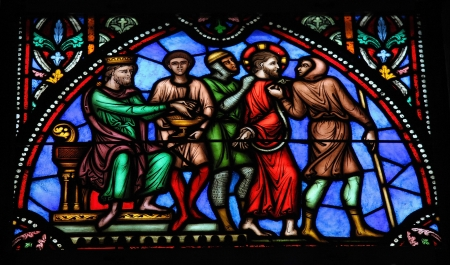 Jesus on Good Friday before Pontius Pilate, on a stained glass window in the cathedral of Brussels, Belgium, on July 26, 2012  This window was created in the 19th Century  No property release is required
