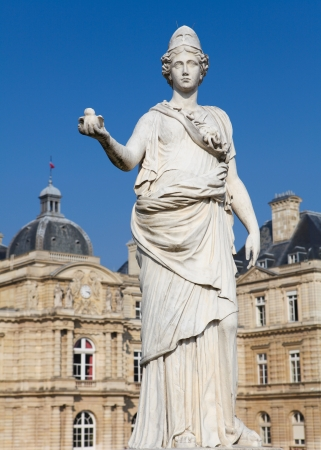 jardin de luxembourg: Statue of Minerva  equated with the Greek goddess Athena  at the Jardin de Luxembourg in Paris, France  This statue was created before 1880, no property release is required  Stock Photo