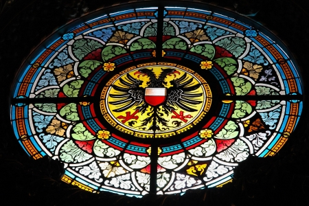 Coat of arms of Lubeck on a stained glass in the town hall of Lubeck, Schleswig-Holstein, Germany. This window was created in the 19th Century, no property release is required. photo