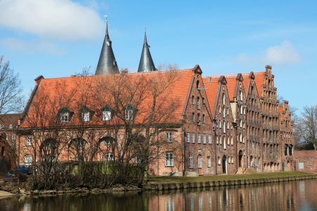 The Salzspeicher  salt storehouses  of Lubeck, Germany, are historic brick buildings on the Upper Trave River next to the Holstentor  the western city gate , built in the 16th-18th Century Editorial