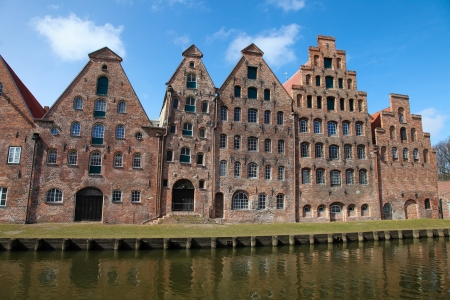 The Salzspeicher  salt storehouses  of Lubeck, Germany, are historic brick buildings on the Upper Trave River next to the Holstentor  the western city gate , built in the 16th-18th Century Banco de Imagens - 19309202