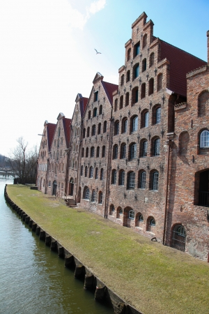 The Salzspeicher  salt storehouses  of Lubeck, Germany, are historic brick buildings on the Upper Trave River next to the Holstentor  the western city gate , built in the 16th-18th Century Banco de Imagens - 19309198
