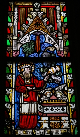 Stained glass window in the church of Our Lady in Saint Truiden, Belgium. This window depicts Leviticus 7:35: This is the portion of the anointing of Aaron. These verses contain a general summing up of the laws which regulate the privileges and duties o
