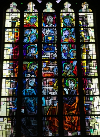 Stained glass window depicting the Last Supper in the church of Our Lady in Saint Truiden, Belgium. This window was created more than 100 years ago, no property release is required.