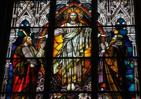 dogma: Stained glass window depicting Jesus Christ, Moses with the Ten Commandments and the Prophet Iesaiah. This window is located in the cathedral of Schwerin, Mecklenburg-Vorpommern, Germany. This window was created before 1893, no property release is require