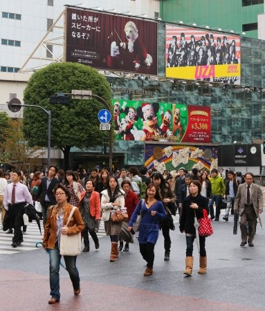 recognized: People crossing the street at the famous Shibuya crossing in Tokyo, Japan on November 12, 2012. Shibuya crossing is one of busiest places in Tokyo and is recognized thanks to being featured in multiple films.