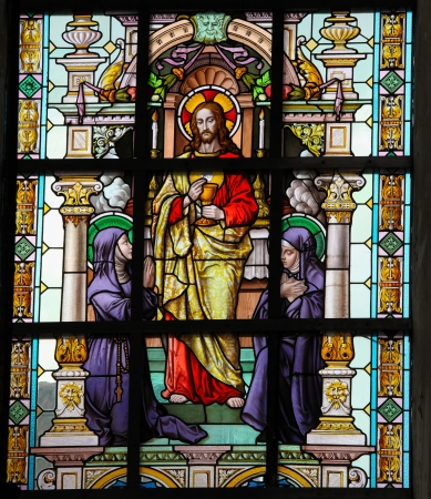 lier: Stained glass window depicting Jesus and two catholic nuns in the Church of the Beguinage in Lier, Belgium  This window was created more than 300 years ago, no property release is required