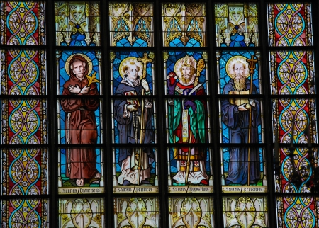stain: Stained glass window in a church of Leuven, Belgium, depicting Saint Francis, Saint Dominic, Saint Augustine and Saint Benedict  This window was created more than 100 years ago, no property release is required