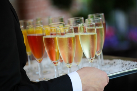 royale: Tray of colorful glasses filled with Champagne Stock Photo