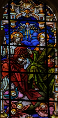 Stained glass window depicting the Holy Trinity in the cathedral of Malaga, Spain, on November 29, 2013  This window was created more than 100 years ago, no property release is required