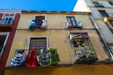 Traditional flamenco dresses at a house in Malaga, Andalusia, Spain  photo