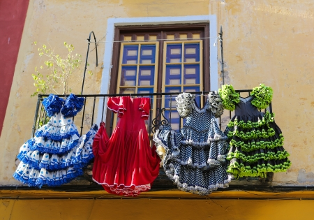 many windows: Traditional flamenco dresses at a house in Malaga, Andalusia, Spain