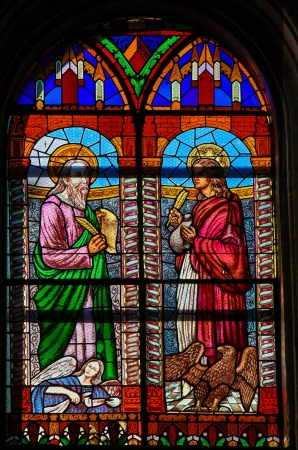 johannes: Stained glass window depicting the evangelists Matthew and John in the church of Ronda, Spain, on December 1, 2013  This window was created more than 300 years ago, no property release is required
