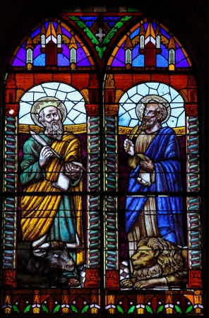 Stained glass window depicting the evangelists Luke and Mark in the church of Ronda, Spain, on December 1, 2013  This window was created more than 300 years ago, no property release is required