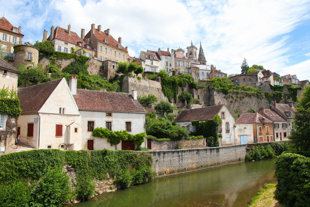 Historic town of Semur en Auxois by the river Armancon in Burgundy, France.