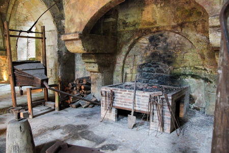 Medieval stone fireplace in the Abbey of Fontenay, Burgundy, France.