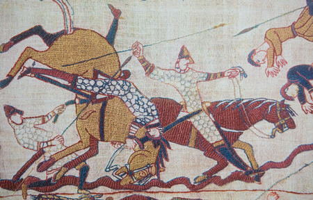 BAYEUX, FRANCE - FEB 12: Detail of the Bayeux Tapestry depicting the Norman invasion of England in the 11th Century on February 12, 2013. This tapestry is more than 900 years old, no property release is required.