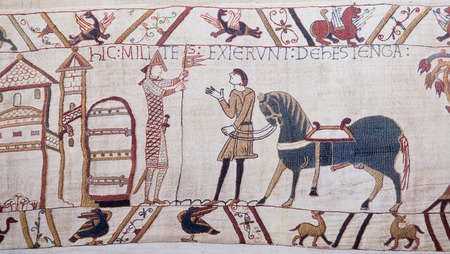 11th century: BAYEUX, FRANCE - FEB 12: Detail of the Bayeux Tapestry depicting the Norman invasion of England in the 11th Century on February 12, 2013. This tapestry is more than 900 years old, no property release is required.