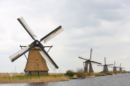 The 19 windmills of Kinderdijk are one of the best-known Dutch tourist sites. photo