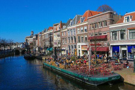 LEIDEN, THE NETHERLANDS - MARCH 16, 2014: The famous river Old Rhine going through the center of Leiden, The Netherlands.