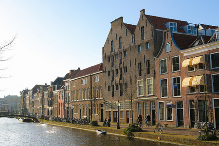 LEIDEN, THE NETHERLANDS - MARCH 16, 2014: The famous Old Rhine going through the center of Leiden, The Netherlands.