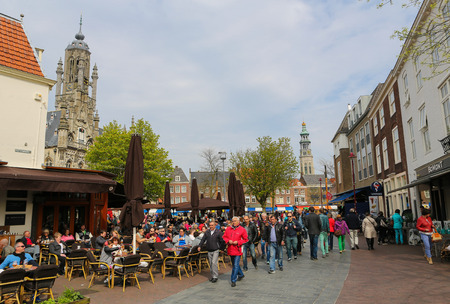 MIDDELBURG, THE NETHERLANDS - APRIL 12, 2014:  Town Hall and Abbey Tower, the two most famous buildings of Middelburg, capital of Zeeland province, the Netherlands.