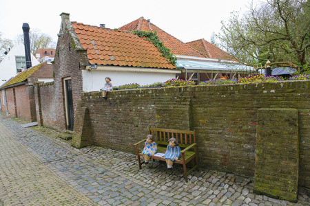 VEERE, THE NETHERLANDS - APRIL 12, 2014:  Small street in the beautiful town of Veere, close to Middelburg, Zeeland, The Netherlands.