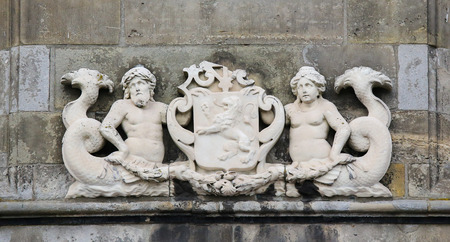 former years: Coat of arms of the former island Schouwen, in Zierikzee, Schouwen-Duiveland, Zeeland province, the Netherlands. This sculpture was created more than 200 years ago, no property release is required.