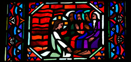 AMIENS, FRANCE - FEBRUARY 9, 2013: Stained glass window depicting Jesus washing the feet of the apostle Peter at the Last Supper on Maundy Thrusday, in the Cathedral of Our Lady of Amiens, France.