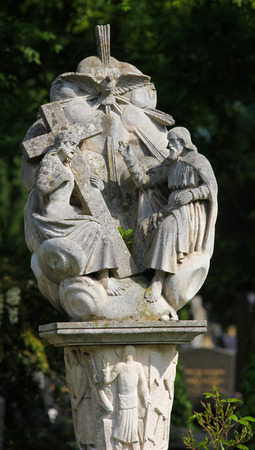 Sculpture depicting the Holy Trinity, Father, Son and Holy Spirit, at the Zentralfriedhof in Vienna, Austria.This sculpture is more than 150 years old,  no property release is required. photo