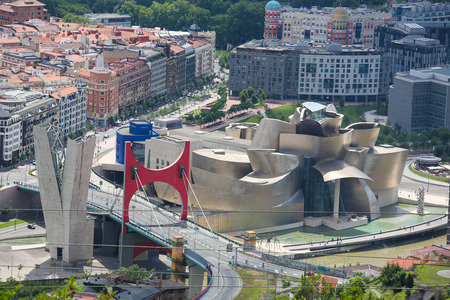 bilbo: BILBAO, SPAIN - JULY 10, 2014: Famous Guggenheim Museum in the center of Bilbao, Basque country, Spain, created by the architect Frank Gehry.