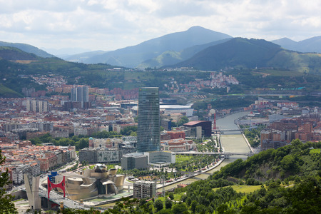 bilbo: BILBAO, SPAIN - JULY 10, 2014: Panorama on the center of Bilbao, Basque country, Spain, with the famous Guggenheim Museum Bilbao by the river Nervion.