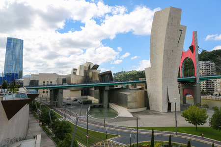 frank gehry: BILBAO, SPAIN - JULY 10, 2014: Famous Guggenheim Museum in the center of Bilbao, Basque country, Spain, created by the architect Frank Gehry.