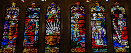 cid: OVIEDO, SPAIN - JULY 17, 2014:  Stained glass window depicting famous historical figures (including El Cid, his wife Jimena Diaz and King Alfonso VI) in the cathedral of San Salvador in Oviedo, Asturias, Spain. Editorial