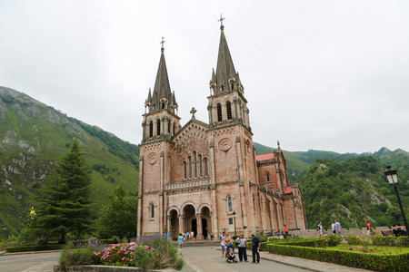 covadonga: COVADONGA, SPAIN - JULY 16, 2014: Basilica of Santa Maria la Real of Covadonga, a famous church in the Picos de Europa, Asturias, Spain. Editorial
