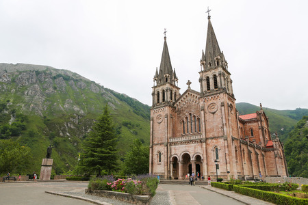 picos: COVADONGA, SPAIN - JULY 16, 2014: Basilica of Santa Maria la Real of Covadonga, a famous church in the Picos de Europa, Asturias, Spain. Editorial