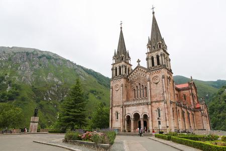 covadonga: COVADONGA, SPAIN - JULY 16, 2014: Basilica of Santa Maria la Real of Covadonga, a famous church in the Picos de Europa, Asturias, Spain. Editorial