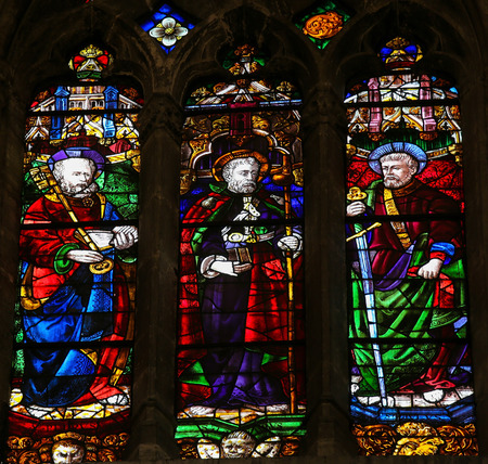 OVIEDO, SPAIN - JULY 17, 2014:  Stained glass window depicting Saint Peter, Saint James and Saint Paul in the cathedral of San Salvador in Oviedo, Asturias, Spain.