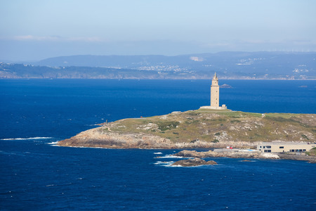 View on the famous lighthouse or Hercules Tower of A Coruna, Galicia, Spain. This lighthouse is more than 1900 years old and is the oldest Roman lighthouse in use today. photo